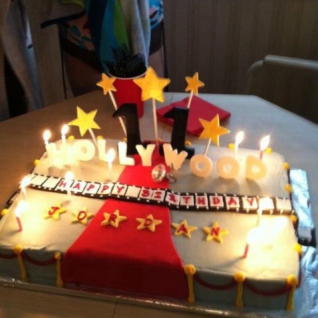 Hollywood cake - like Hollywood sign, ropes on side, stars.