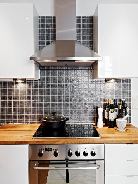 Back Splash - simple small tile and what do we think about some butcher block tops? Wonder if this photo is from IKEA?