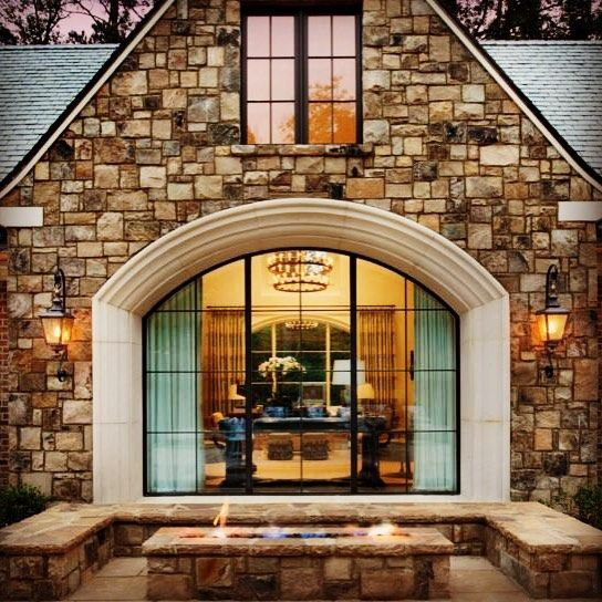 Beautiful stonework and a stunning arched window combine to make a powerful focal point in this Georgia home. #WindowWednesday #WindsorWindows #WindsorPinnacle #archedwindows #woodwindows #cladwindows #imaginetheview