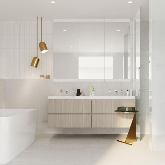 Statement pendant lights in the bathroom - just love these twin brass pendants! They create a statement in this otherwise soft and neutral bathroom.