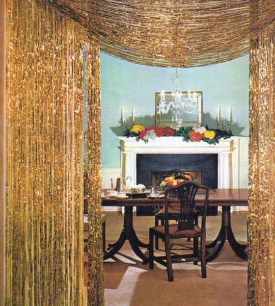 """Top: A happy housewife can't believe the abundance of Christmas presents she sees in an 1960s ad for Reynolds Metals foil gift wraps. (From Mid-Century Christmas, reproduced with permission from Reynolds Consumer Products) Above: Gold tinsel curtains adorn the entry to a dining room in the December 1961 """"House Beautiful."""" (From Mid-Century Christmas, reprinted with permission of Hearst Communications, Inc.)"""