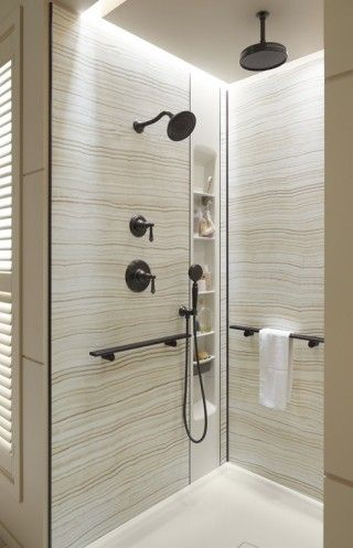"""<p>Marble-patterned walls, smart shower barres and a shower locker shelf are a few the features of the Choreograph shower system.</p>  <a href=""""http://www.us.kohler.com/webassets/kpna/brochures/Choreograph_RecipeCard_SmShower.pdf"""">See the products. </a>"""