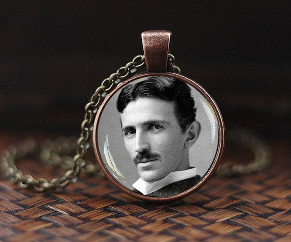 Nikola Tesla photo necklace. A vintage-style chain, length upon your choice with lobster clasp comes with antique bronze color pendant 1 inch (25mm) diameter . Necklace ready to wear immediately out of package.  All images are crafted by myself and printed. On top I put dome crystal glass to cover and protect from ambient. Your necklace comes in a beautiful organza gift bag.  No resin, epoxy or plastic used in my products. Only a highest quality Glass and metal.  Pendants are water resistant…