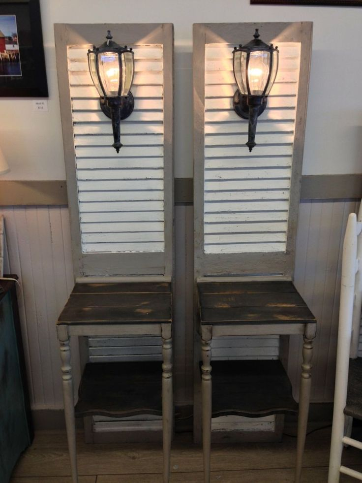 Shutters turned into bedside tables.  I can actually see them used on a front porch..at least with those fixtures attached.