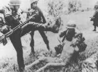 A Vietcong is abused by South American and American soldiers - Vietnam War  http://www.hagdise.in/forum/usa1/vietnam.htm
