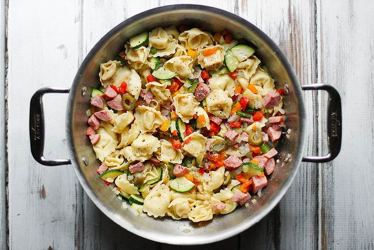 An easy weeknight meal that tastes like you spent hours on it! Lean smoked turkey sausage tortellini with sauteed vegetables in a quick-but-luscious garlic sauce is a real family pleaser, with savory sausage, cheese-filled tortellinis ... and lots of veggies to make Mom happy!. Get the recipe at SoupAddict.com