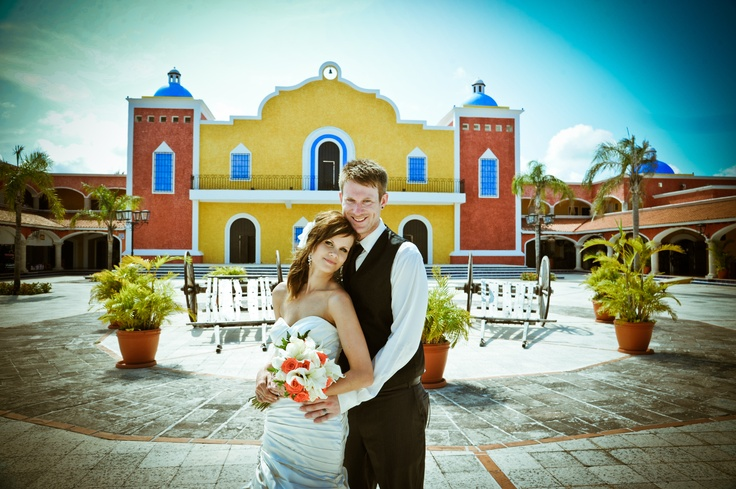 The buildings of the Grand Bahia Principe Akumal in Riviera Maya provide a colourful backdrop for couple Gena & Trevor! Destination wedding by Roblin Travel in Chilliwack, BC.