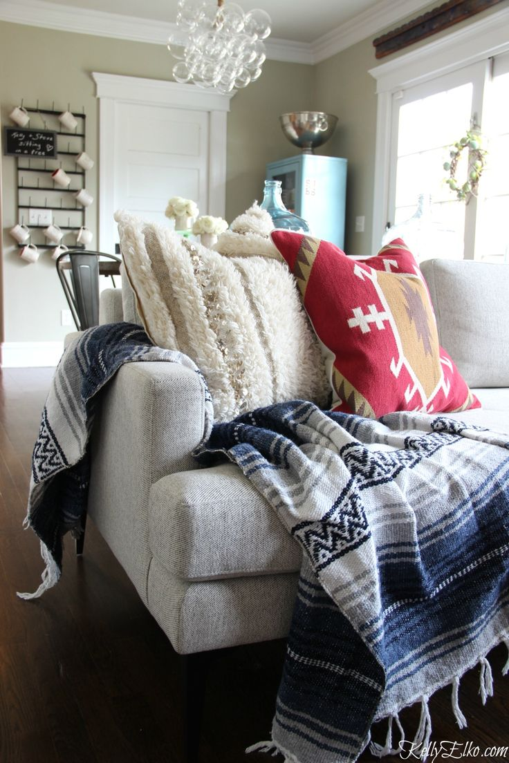 Love this modern sofa with a mix of textiles - Mexican blanket with Kilim and Moroccan pillow from HomeGoods kellyelko.com sponsored pin