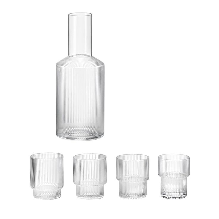 Mouth blown into the mould, this stackable glassware collection features a beautiful rippled surface paired with an elegant carafe. The vertical ripples add a strong and sophisticated look, while the stepped-shape allows the glasses to be stackable. A full set of four Ripple Glasses and a Ripple Carafe. Dishwasher safe. Drawing on Scandinavian design traditions …