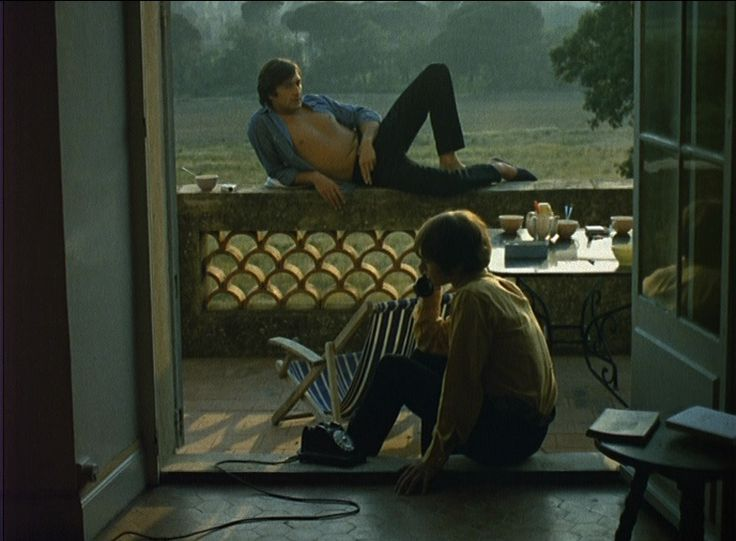 Talking on the phone while sitting on the doorstep to your porch // La Collectionneuse // Rohmer