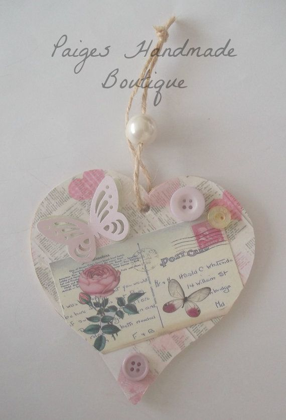 Handmade wooden decorative hanging heart keepsake with butterfly and button embellishment.