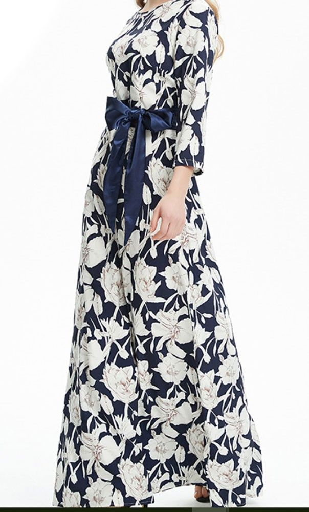 Modest 3/4 sleeve maxi dress with navy and white floral print and matching ribbon belt