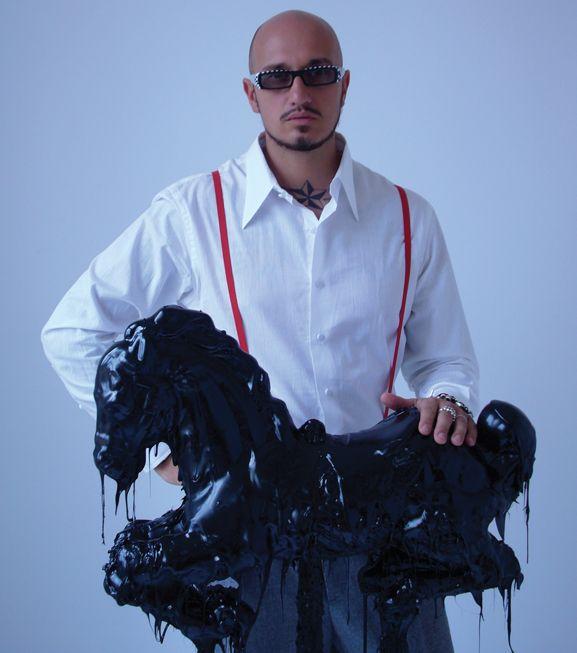 NGMA artist Mattia Biagi with one of his  famous tar sculptures.