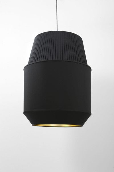 Rich Brilliant Willing: Delta is a series of fabric shades based on traditional box pleating techniques. Resembling a rocket engine, this product was named after an astrodynamic number (Delta-v) making it a space and earth friendly fixture. Available as a wall sconce, table lamp, floor lamp or pendant fixture, this product can be placed in any interior setting..