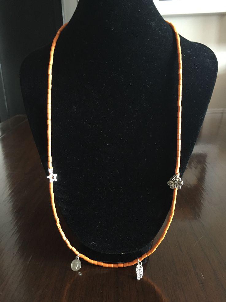 Orange charm single strand necklace