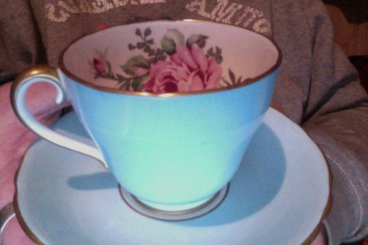 Adderley Bone China, Harlequin set of six. A Harlequin tea set is made up of individually coloured cups and saucers.  This set has pale blue, pink, maroon, green, mauve, yellow all with the pink rose motif on the inside of the cup and printed on the saucer where the cup rests.
