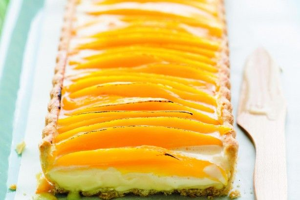 This tart goes troppo with a lemongrass custard and juicy fresh mango.