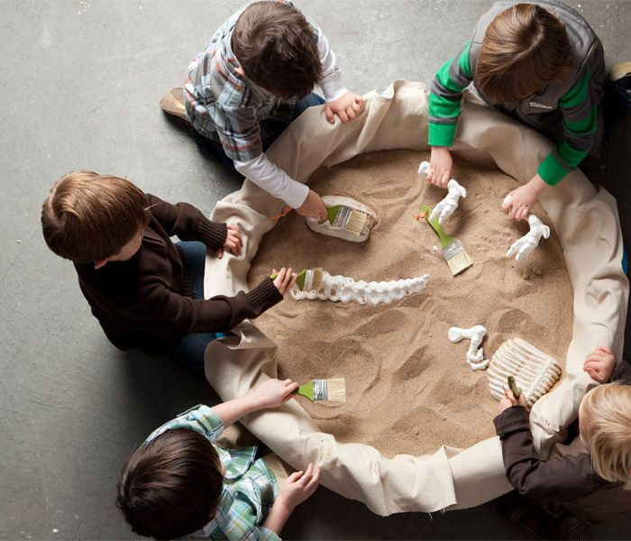 This would be so cool for a craft at dino party. Sandbox filled with sand (of course) and different dino fossils. They would have so much fun unraveling these at bday party.