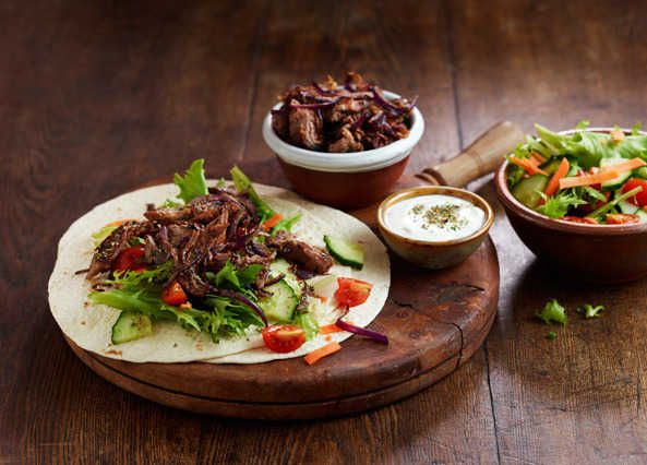 Drizzled with tzatziki, these wraps topped with pan-fried leftover lamb and fresh salad are ready in just 12 minutes