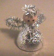 USE HERSHEY KISSES OR HUGS...There are so many kinds of kisses, Some for love, and some for good wishes. But here is the one that can't be beat-- Angel Kisses--so wonderful and sweet