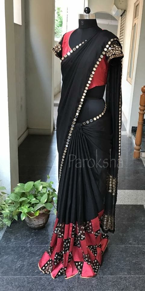 black saree with red accents and mirrors