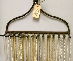 Use a old rake head to hang jewerly on