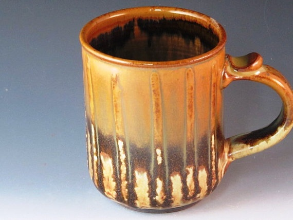 Mug With Beautiful Runny Rust Yellow Glaze With Slip by potmaker, $18.00