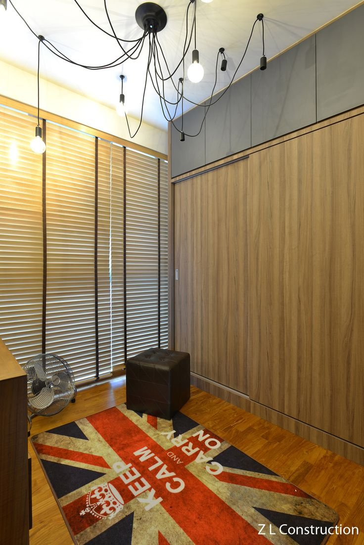 Z L Construction (Singapore) // Dressing room with full height sliding cum casement wardrobe and Keep Calm and Carry On British carpet