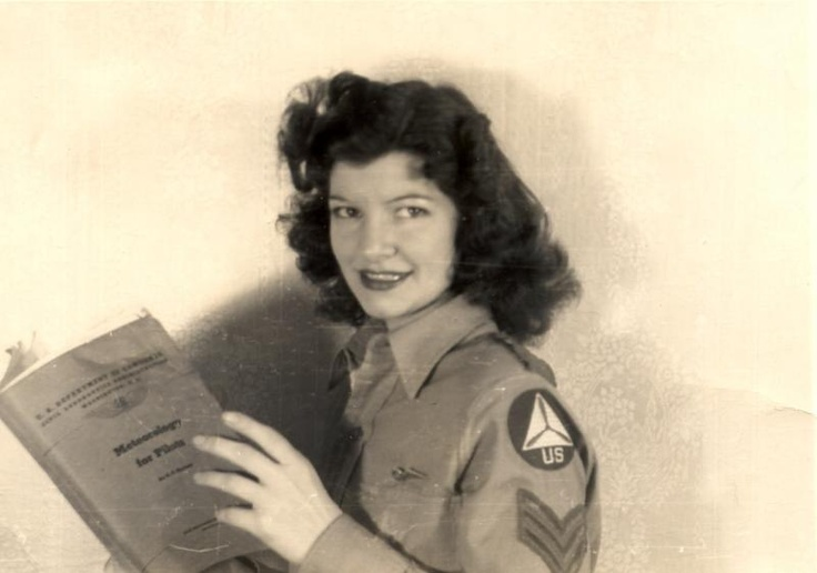"""Un-named WWII Civil Air Patrol member studying """"Meteorology for Pilots. The CAP was formed in the early days of the war to assist with patrolling the US coast. """"In the 18 months before the navy took over patrol duty, the CAP spotted 173 U-boats, located 363 survivors of sunken ships and downed aircraft, and reported 91 ships in distress... By the end of the war, 64 CAP members had lost their lives in the line of duty."""""""
