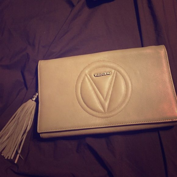 Valentino crossbody/clutch Taupe Valentino crossbody/clutch. Like new condition, comes with dustbag and authenticity card. $200 on M Valentino Bags Crossbody Bags
