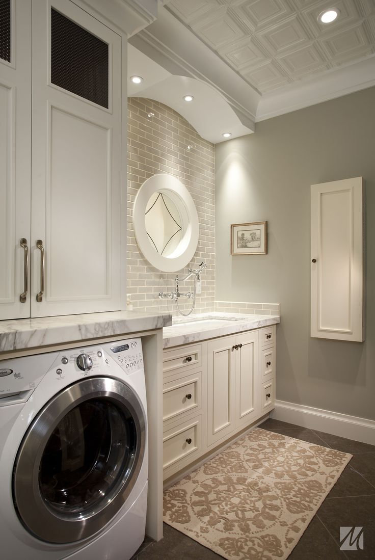Laundry Room Sinks Cabinet Is Completed With Round Mirror And Brown Carpet For Luxury Laundry Room Design With Cream Painting Ideas: Laundry Room Sink Ideas with Various Style