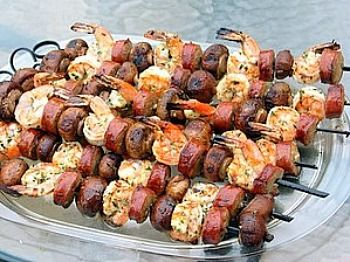I used this recipe on the grill with friends.  It was a huge hit and so easy!  This recipe is from Lori Lange, Recipe Girl.  Mixed Grill of Shrimp, Sausage and Mushrooms
