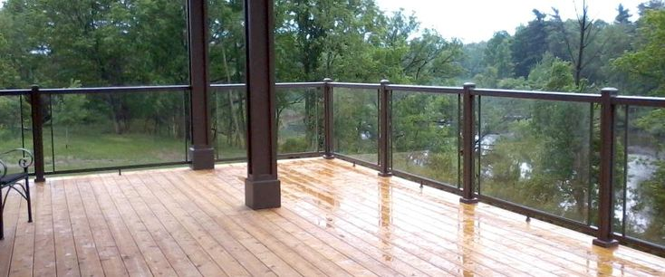 Patio Deck Railing with Glass View plenty Deck Railing Ideas http://awoodrailing.com/2014/11/16/100s-of-deck-railing-ideas-designs/