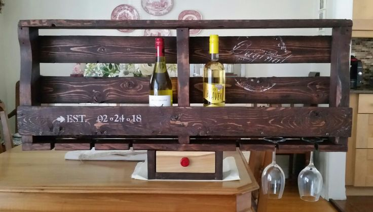 Our take on wood pallet wine rack. Red elm drawer face with wine cap knob.