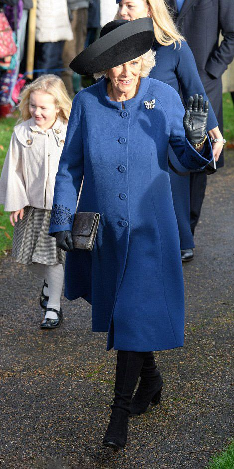Camilla, Duchess of Cornwall wore a long blue royal blue coat with black accessories