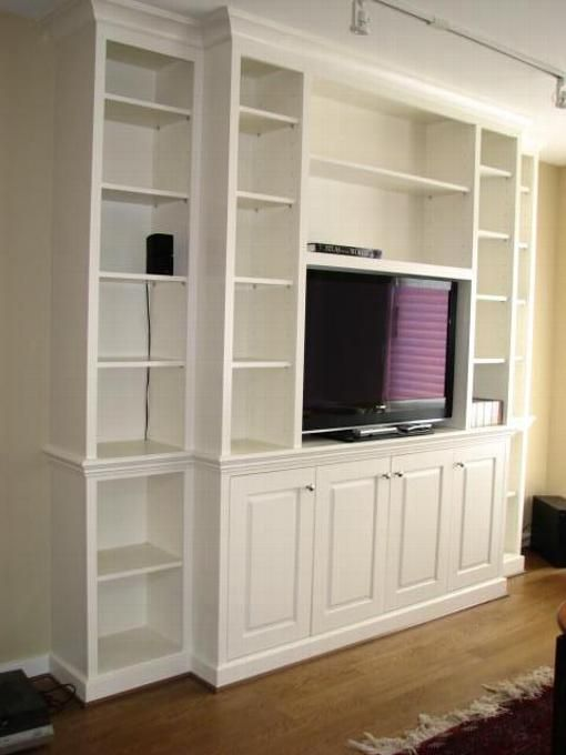 Wall unit with base cabinets MUST HAVE THIS when we finally replace our  front room TV.