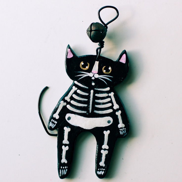 Skeleton Cat Halloween Clay Folk Art Ornament. $11.50, via Etsy.