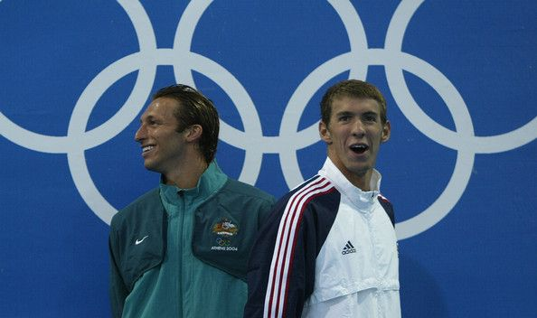 Michael Phelps Photos Photos - Gold medalist Ian Thorpe of Australia smiles next to bronze medalist Michael Phelps of USA during the medal ceremony for the men's swimming 200 metre freestyle event on August 16, 2004 during the Athens 2004 Summer Olympic Games at the Main Pool of the Olympic Sports Complex Aquatic Centre in Athens, Greece. Pieter Van Den Hoogenband of the Netherlands finished second. - Olympics Day 3 - Swimming