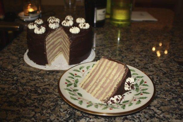 Eight thin layers of cake filled with chocolate butter cream. Pipe whipped cream rosettes and sprinkle over them with chocolate flakes.