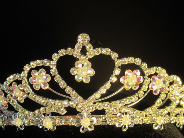 Rhinestone  heart  tiara  with  small  pearls  hand  decorated  with  Swarovski  Crystal AB  crystals - $31.95 For  more  info  please  contact - Shoot  for  the  Moon  Jewelry  Designs (850) 230-9983 #Tiaras #bridaltiaras #rhinestones