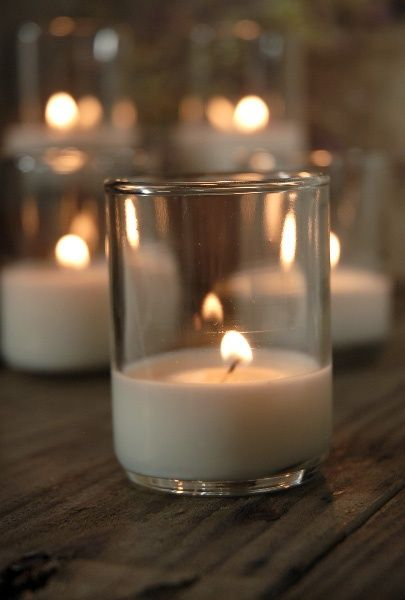 48 votive candles for $25.00- Great site for discounted candles and centerpiece components for weddings and events
