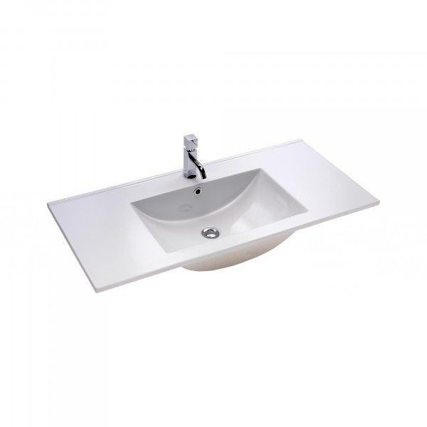 149€ Lavabo de porcelana CODIGO II de 101x46 cm. Formas suaves y simples caracterizan esta serie. Fabricado en porcelana. Gran resistencia a los impactos. Sin esquinas interiores que facilitan su limpieza. Dispone de prácticos espacios laterales para colocar tus accesorios de baño. Fondo 46 cm.