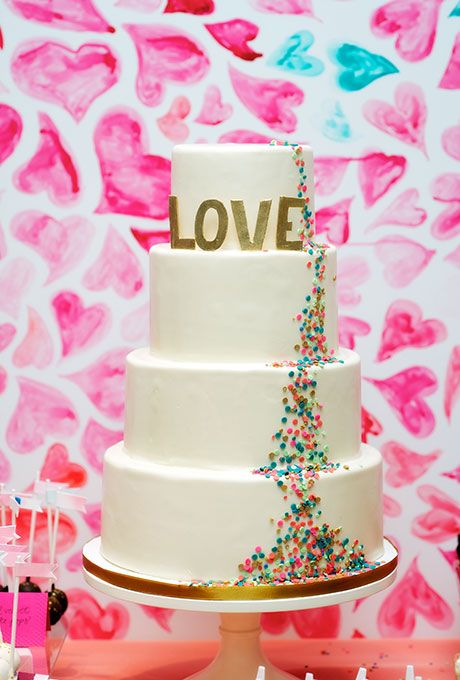 Brides: Four-Tiered White Cake with Jewel-Toned Sprinkles. A trail of jewel-toned confetti makes its way down this four-tiered wedding cake.