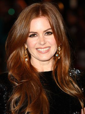 Isla Fisher's Vibrant Coppery Red--Isla's dazzling red is au naturel, but your colorist can copy it by mixing papaya and golden apricot tints, then applying the combo as a single-process dye, says Redken colorist Tracey Cunningham. Red-dye molecules are larger than other shades, so they shampoo out faster. Use low-sulfate washes (like Tresemmé Naturals Shampoo, $6) to fight the fade