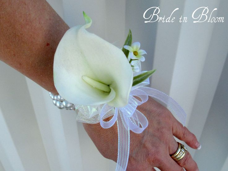 Cream calla lily wrist corsage champagne ivory or white pearls. $25.00, via Etsy.