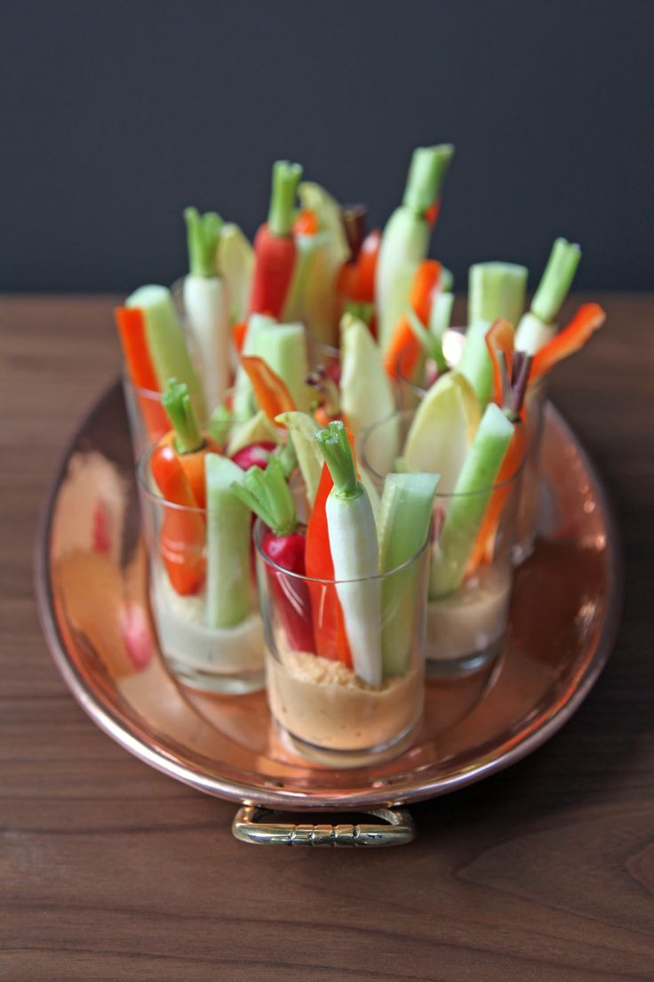 When hosting a party, it's easy to get caught up in planning, making lists as long as the eye can see of appetizers and drinks you'd love to make. Why not work smarter, not harder, and make these adorable individual hummus and crudités shots?