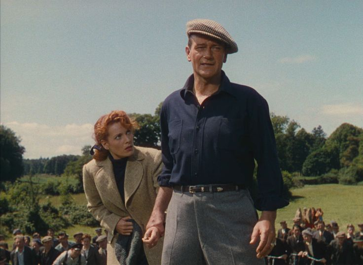 Love this scene! Especially love the villagers following along! The Quiet Man (1952) John Wayne, Maureen O'Hara, Barry Fitzgerald - Director: John Ford - An American boxer travels to the town in Ireland where he was born and falls for a fiery redhead.