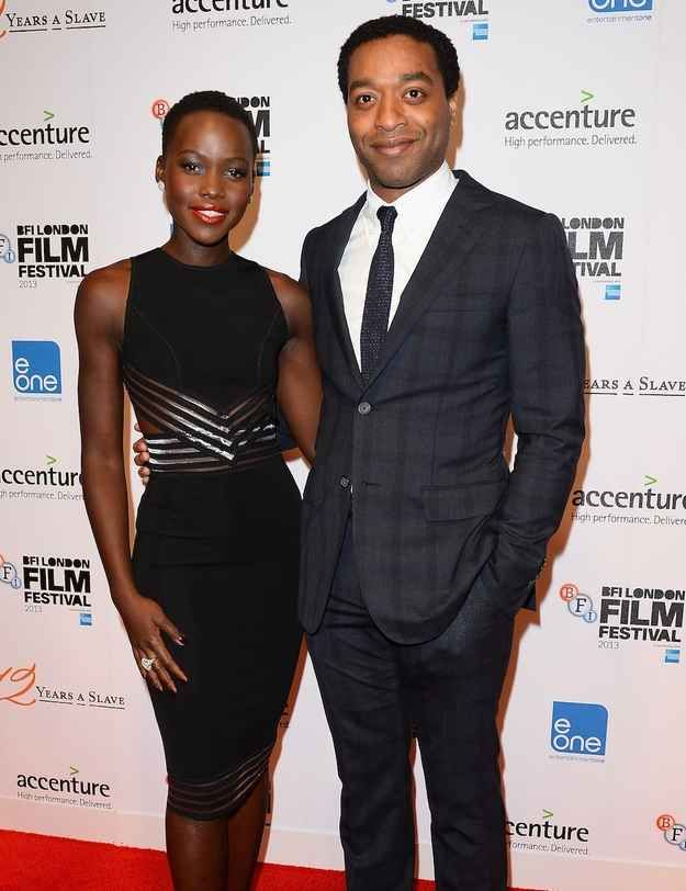 """...but also oozes goddess in this sleek, formfitting little black dress. 