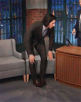 Adam in his tight suit on Late Night with Seth Meyers