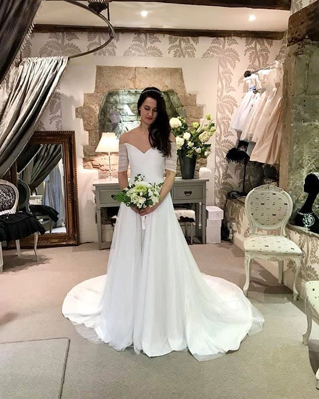 96efebf38d67f Softly corseted silk tulle with feminine off the shoulder styling for  seductive and gentle romance. Flowers by The Petal Shed. Wedding dress from  Carina ...